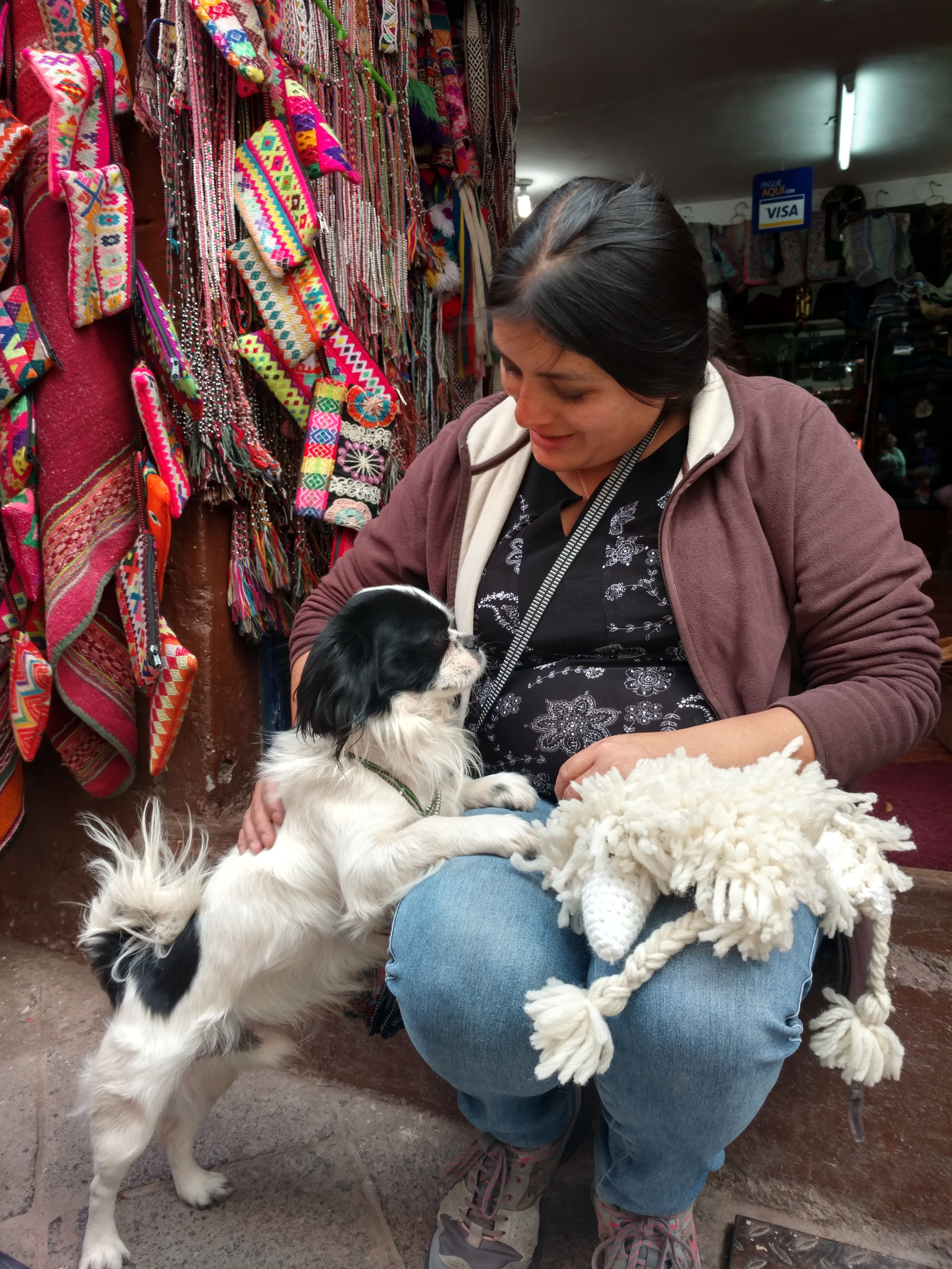 woman in market with dog