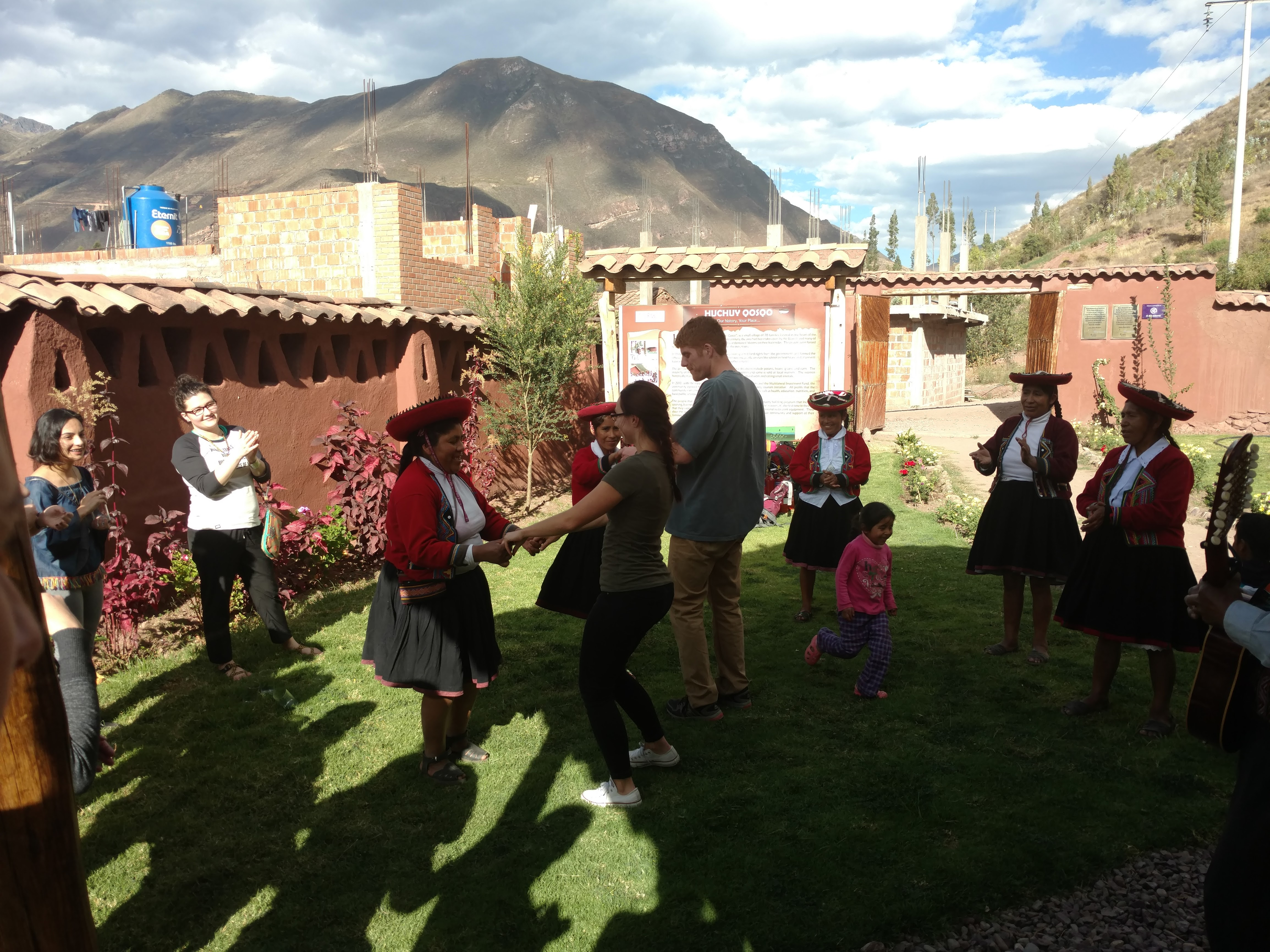 Quechua women dancing with exchange students.