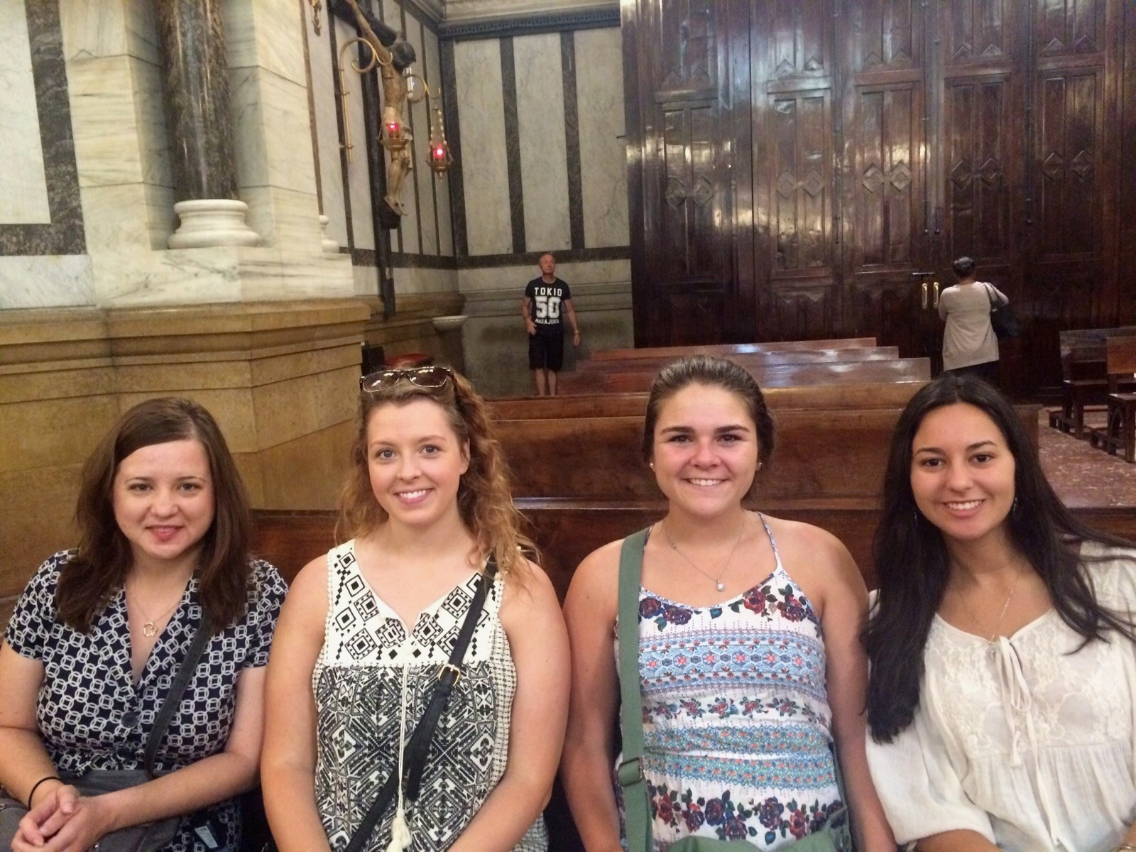 My roommates and I at mass (with our host family).