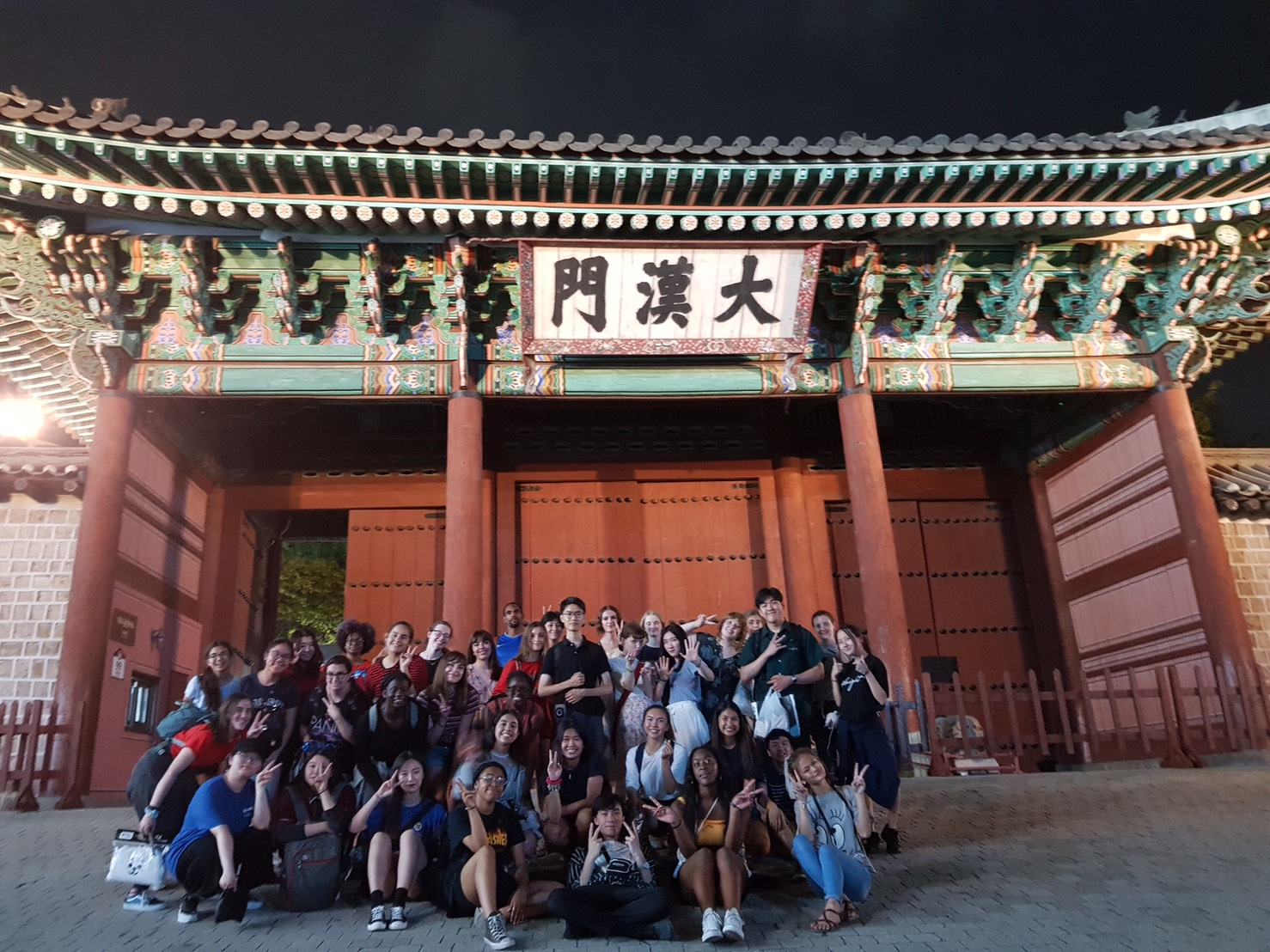 Group picture of students and leaders in front of Deoksu Palace in Seoul, South Korea.
