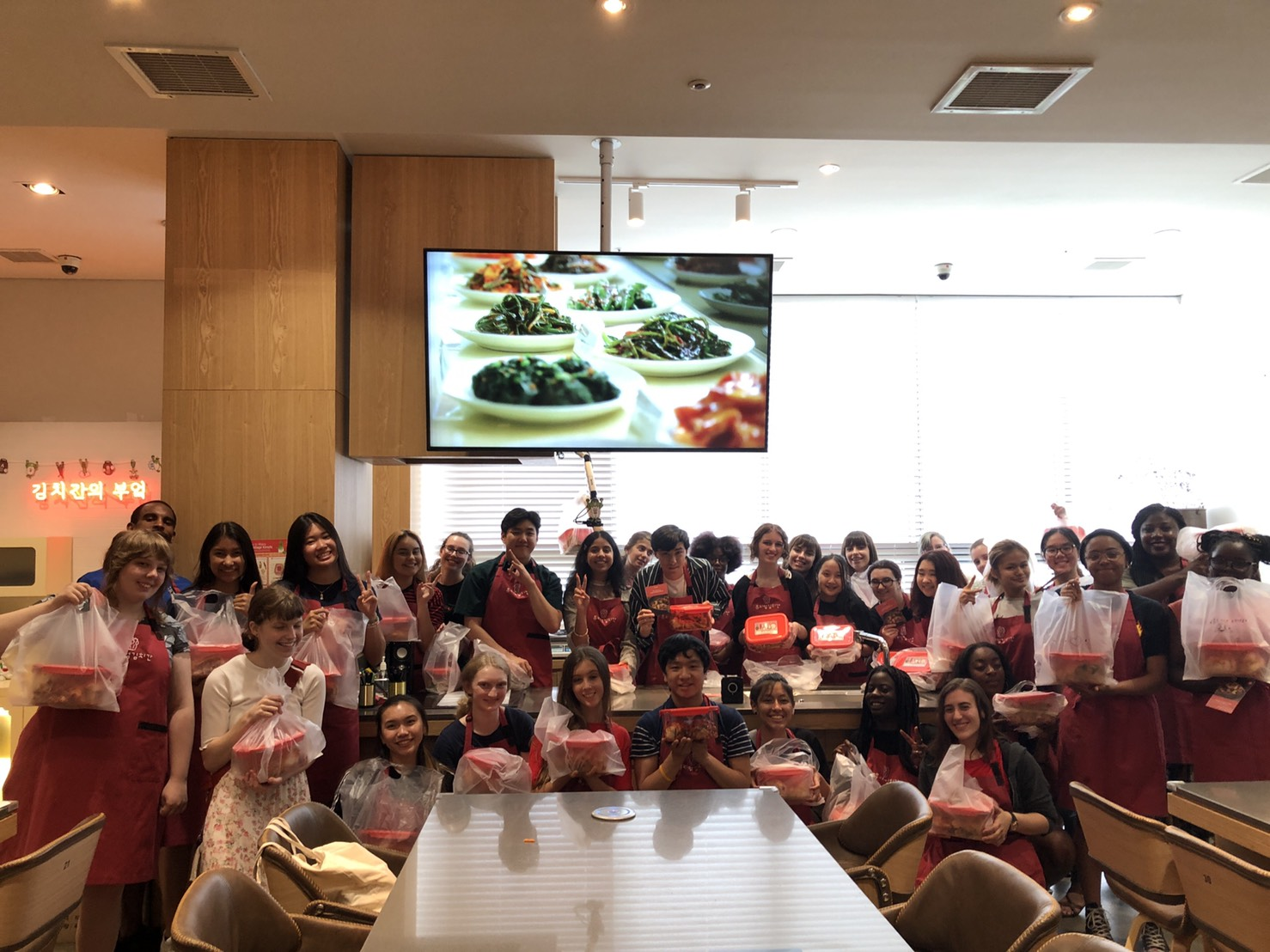 Group picture of students holding their finished containers of Kimchi.